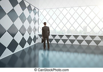 Young businessman in chessboard interior - Young businessman...