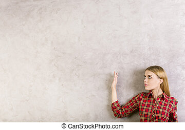 Female with hand up - Side view of young blonde female with...