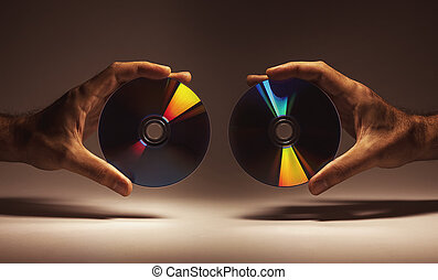 Compact Disks in Hands - Conceptual composition, CDs in male...