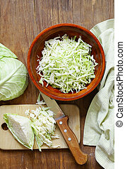 fresh sliced cabbage on a wooden board