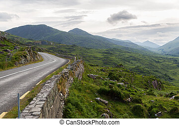 asphalt road and hills at connemara in ireland - travel,...