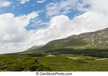 view to plain and hills at connemara in ireland - nature and...