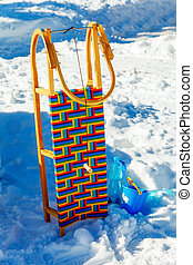 Wooden sledge in the snow Isolated on blue and white...