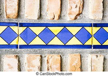 Close-up of ceramic line on cement wall - Close-up of bright...