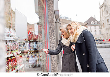 Women window shopping in centre of the city. Winter - Two...