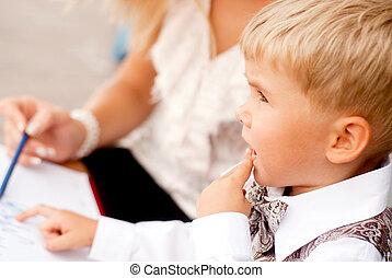 child businessman - Baby blond businessman examines...