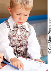 child businessman - Baby businessman studying drawings on...