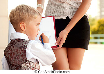 child businessman - Baby blond businessman examines...