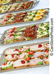 Buffet with appetizers or finger food - Buffet on a long...