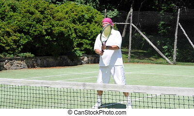 tennis player volley stroke - senior middle age tennis...