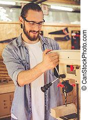 Handsome carpenter working