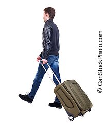 back view of walking  man  with suitcase.