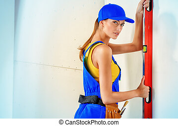 female builder - Happy smiling woman construction worker...