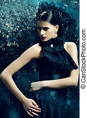 gothic style - Gothic brunette woman in long black dress and...