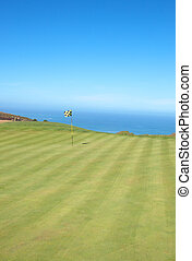 Golf course landscape by the ocean - Golf course landscape...