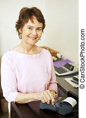Store Clerk Runs Credit Card - Friendly store clerk running...