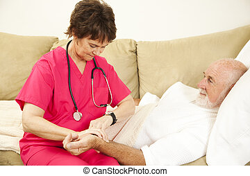Taking Patient\'s Pulse - Home health nurse taking the pulse...