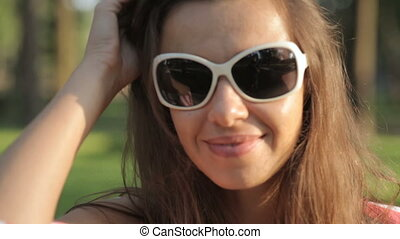 Woman in sunglasses in park