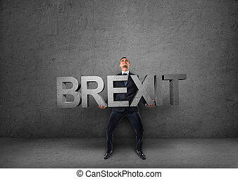 Businessman holding heavy 3d brexit word in his hands -...