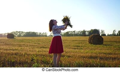 girl with a bouquet of flowers at sun