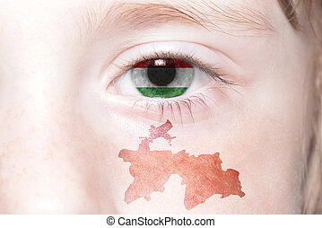 human's face with national flag and map of tajikistan....