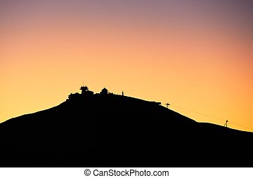 Amazing sunrise in the mounatins. Silhouette of the Snezka -...
