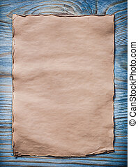 Vintage blank paper sheet on wooden board top view