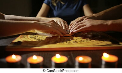 group of people at a spiritualistic. people call spirits -...