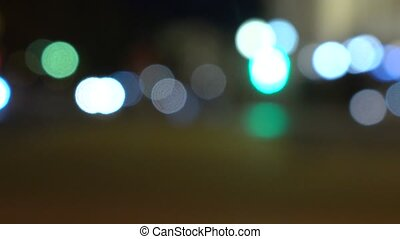Evening street. Lights and cars. 4K background bokeh shot -...
