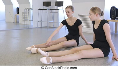 In model school females are preparing for dance class....