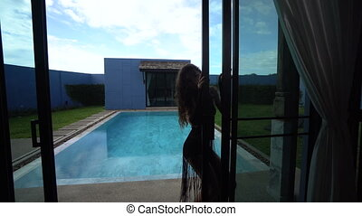 Beautiful seductive brunette woman in a luxurious villa -...