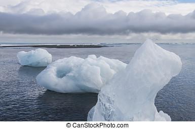 Three Ice Blocks on Beach, Iceland - Three Ice blocks on...