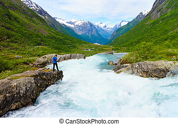 Tourist woman by Videfossen Waterfall in Norway - Travel,...