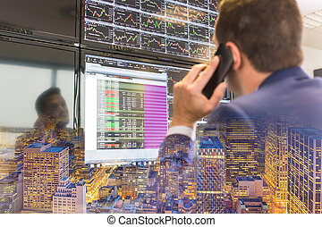 Stock trader looking at computer screens. - Businessman with...