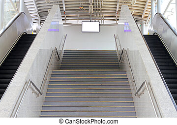 escalator stairs and sign board