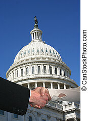 handshake with US Capitol building - handshake between...