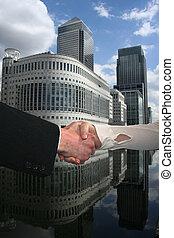 handshake with Docklands skyline - handshake between...