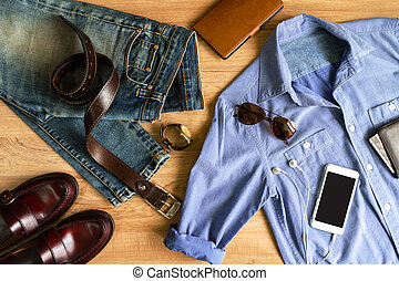 Flat lay of men casual fashion outfits on wooden background,...