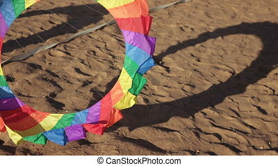 Floating multi-colored parachute - Above sand floating Air...