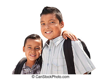 Young Hispanic Student Brothers Wearing Their Backpacks on...