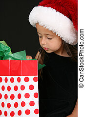 Christmas Gift - Beautiful young brunette girl looking into...