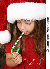 Christmas Girl - Beautiful brunette christmas girl eating a...
