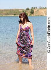 Brunette girl on the lake