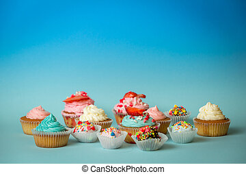 Closeup of different tasty sweets on blue background -...