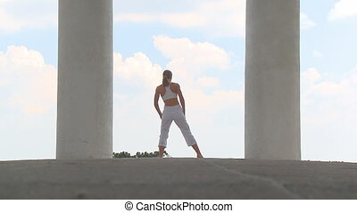 Yogatemple 002 - woman practising yoga between two pillars