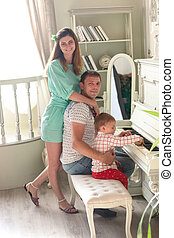 Toned image of happy family posing in luxurious interior...