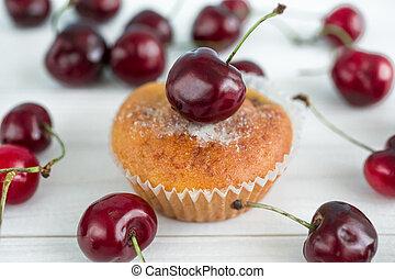 Macro photo of homemade muffin with cherries - Macro photo...