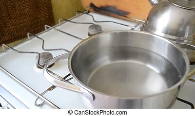 Water starts to boil in saucepan - Water starts to boil in...