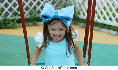 little girl three years with the blue bow on her head