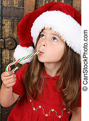 Christmas candy - Cute brunette girl wearing a christmas...